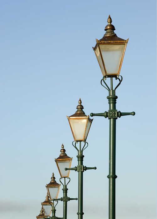 Medium Group Of Objects Greeting Card featuring the photograph A Group Of Old Gas Street Lamps by Bill Hatcher