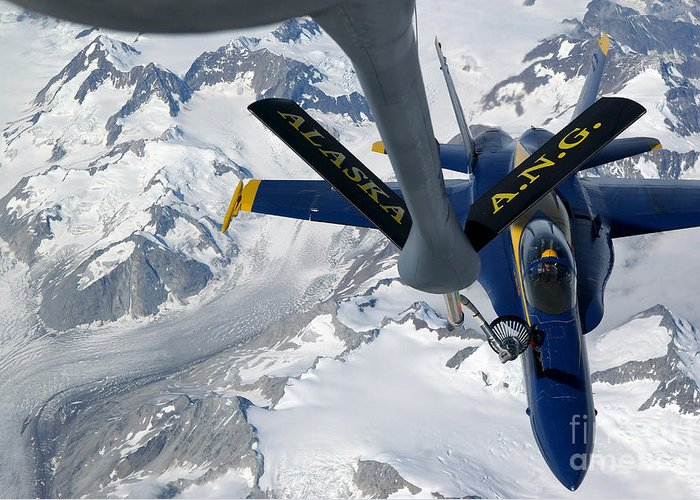 Horizontal Greeting Card featuring the photograph A Kc-135 Stratotanker Refuels An Fa-18 by Stocktrek Images
