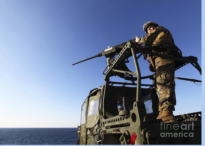 Camouflage Clothing Greeting Card featuring the photograph A Machine Gunner Mounts A M-2 by Stocktrek Images