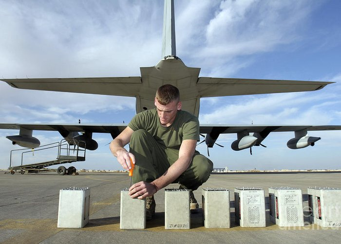 Aircraft Greeting Card featuring the photograph A Marine Replaces Flares In Flare by Stocktrek Images