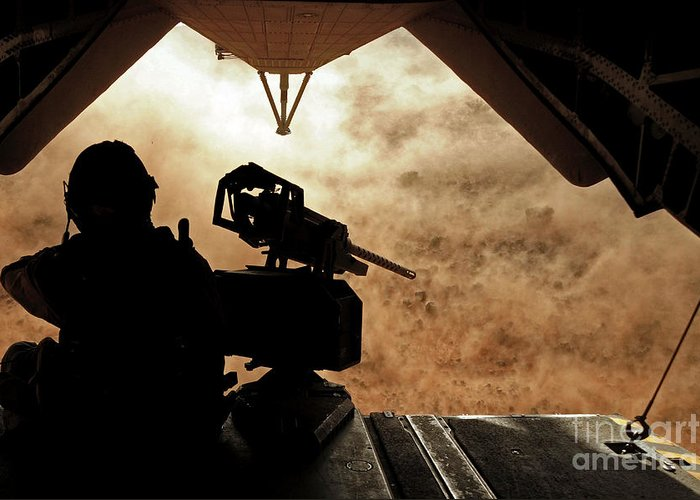 Dust Greeting Card featuring the photograph A Marine Waits For Dust To Clear While by Stocktrek Images