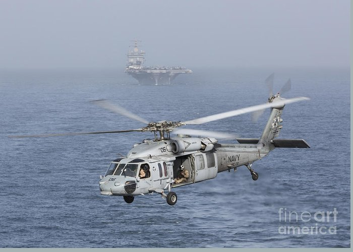 Arabian Sea Greeting Card featuring the photograph A Mh-60s Knighthawk Conducts A Vertical by Gert Kromhout