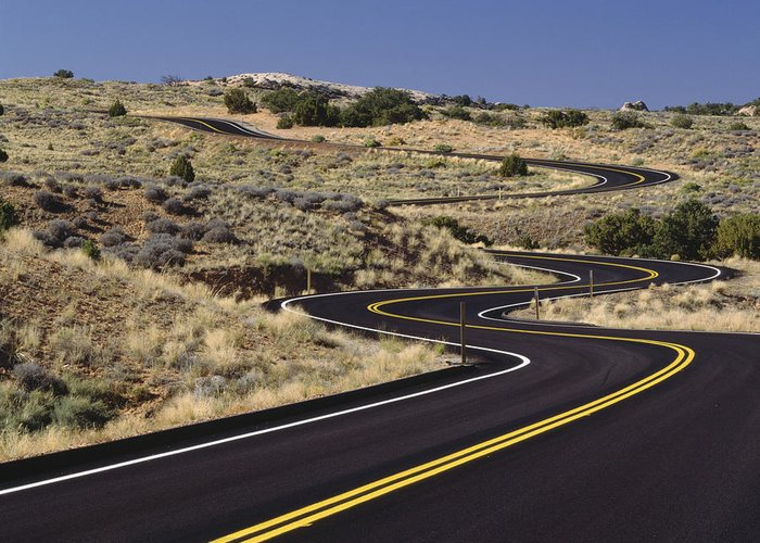 No People Greeting Card featuring the photograph A Newly Paved Winding Road Up A Slight by Greg Probst