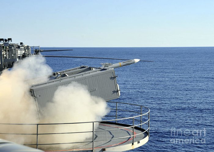 Rim-7 Greeting Card featuring the photograph A Rim-7 Sea Sparrow Is Launched by Stocktrek Images