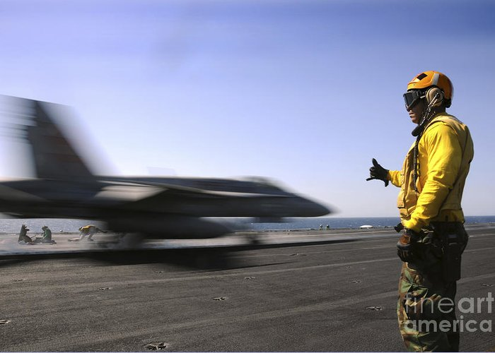 Uss Enterprise Greeting Card featuring the photograph A Sailor Ensures An Fa-18c Hornet by Stocktrek Images