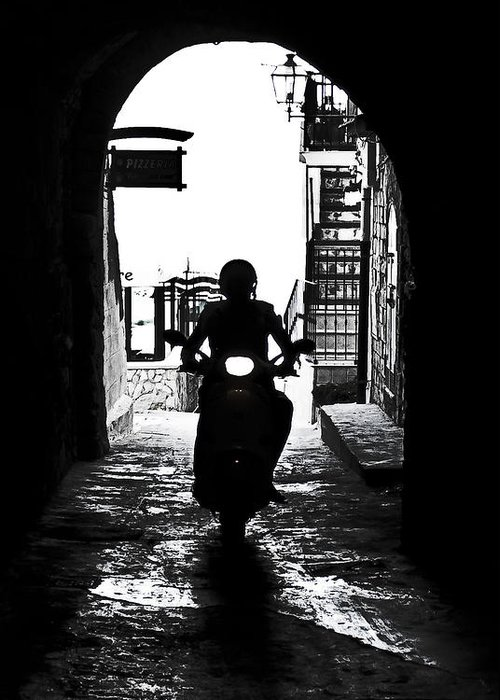 Lane Greeting Card featuring the photograph a scooter rider in the back light in a narrow street in Italy by Joana Kruse