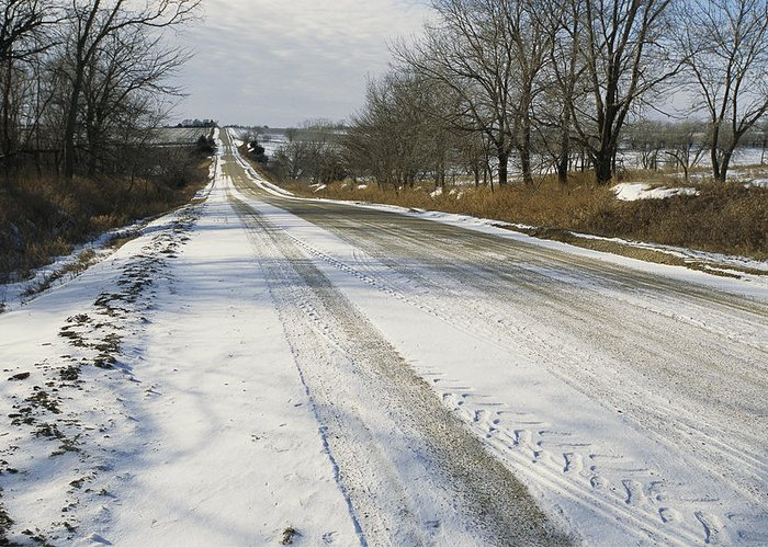 North America Greeting Card featuring the photograph A Snow-covered Road Passes by Joel Sartore