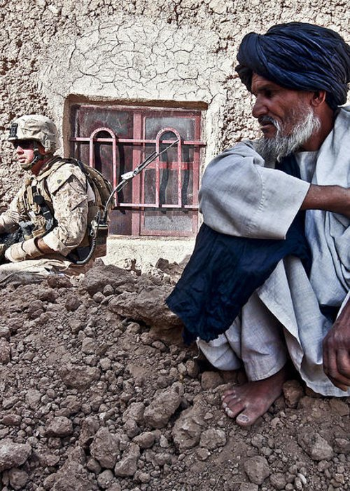 Middle East Greeting Card featuring the photograph A Soldier Collects Information by Stocktrek Images