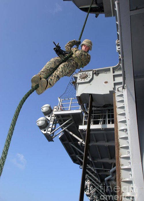 Aircraft Greeting Card featuring the photograph A Soldier Fast-ropes From The Rear by Stocktrek Images