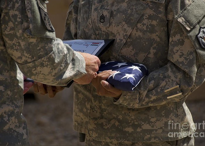 Airmen Greeting Card featuring the photograph A Soldier Is Presented The American by Stocktrek Images