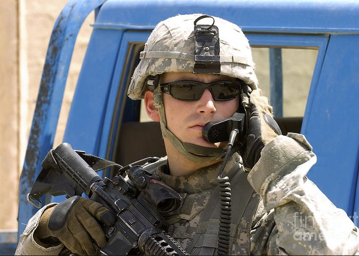 Operation Iraqi Freedom Greeting Card featuring the photograph A Soldier Talking Via Radio by Stocktrek Images