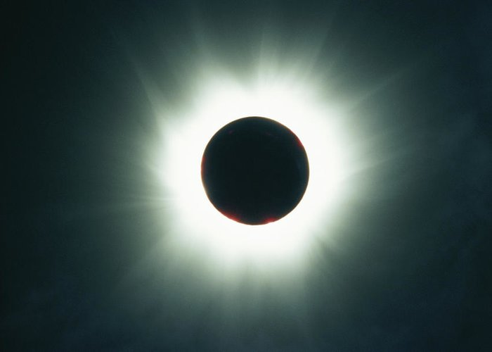 Color Image Greeting Card featuring the photograph A Total Solar Eclipse Over France by Carsten Peter