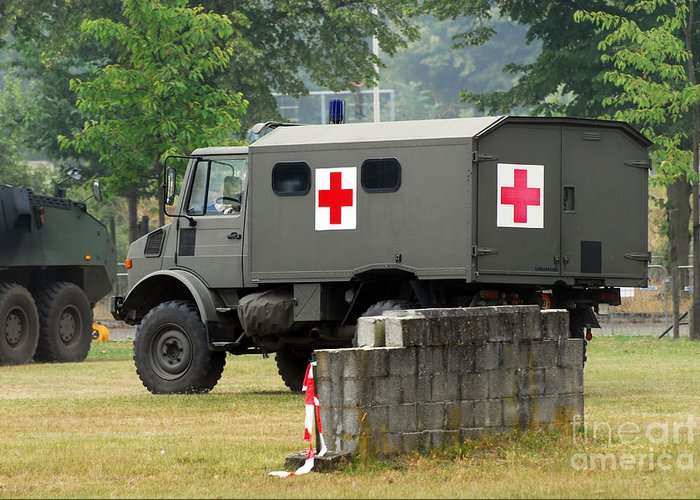 Military Greeting Card featuring the photograph A Unimog In An Ambulance Version In Use by Luc De Jaeger