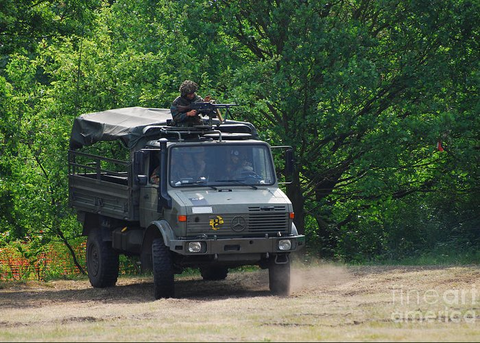 Unimog Greeting Card featuring the photograph A Unimog Vehicle Of The Belgian Army by Luc De Jaeger