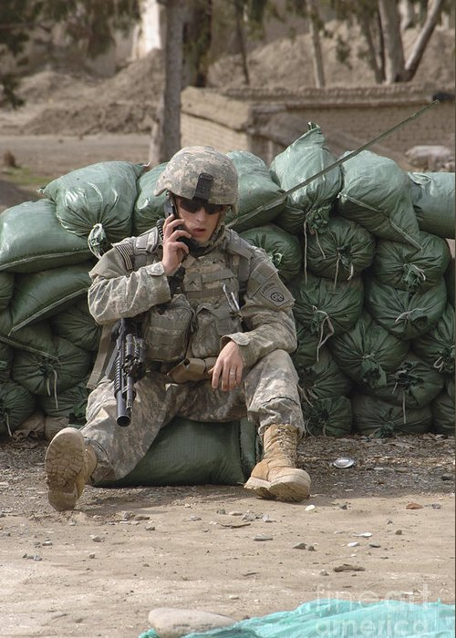 Afghanistan Greeting Card featuring the photograph A U.s. Army Soldier Talks On A Radio by Stocktrek Images