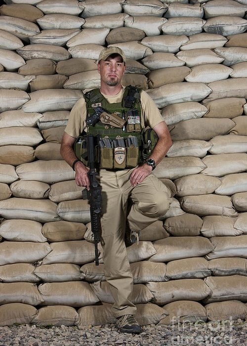 Operation Enduring Freedom Greeting Card featuring the photograph A U.s. Police Officer Contractor Leans by Terry Moore