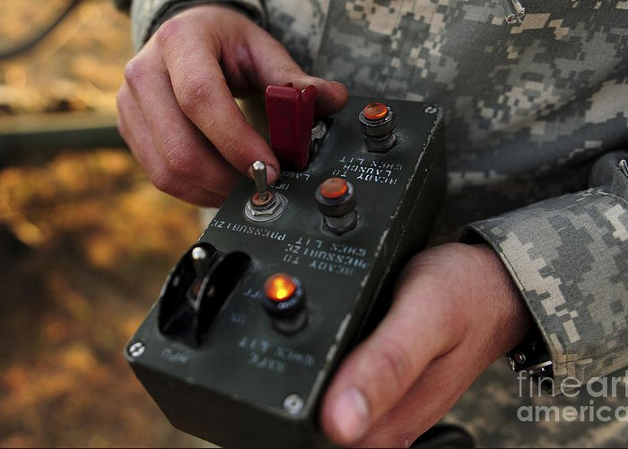 Military Greeting Card featuring the photograph A U.s. Soldier Hits The Button by Stocktrek Images