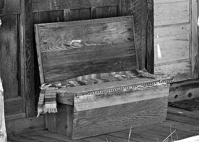 Bench Greeting Card featuring the photograph A Weathered Bench Black And White by Phyllis Denton