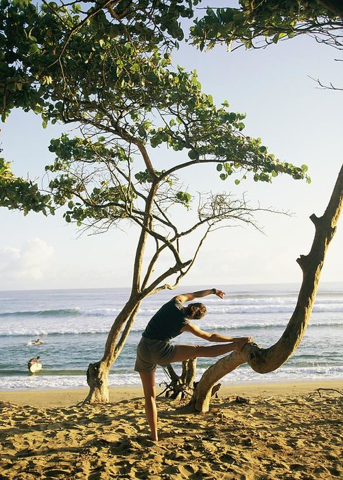 Atlantic Islands Greeting Card featuring the photograph A Woman Stretches On A Beach by Skip Brown