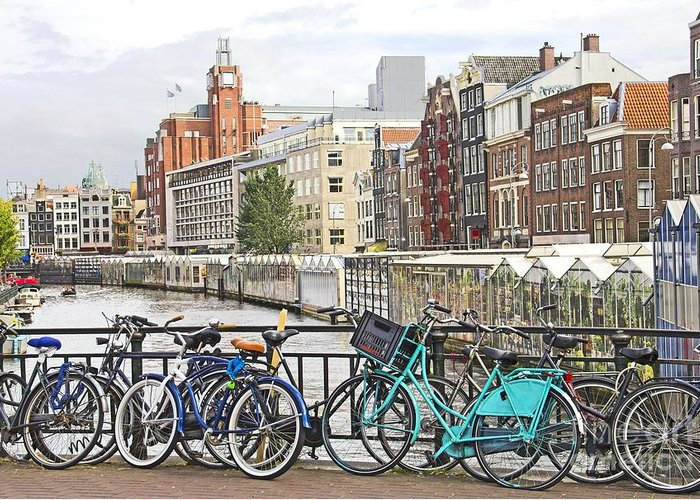Amsterdam Greeting Card featuring the photograph Amsterdam Canal And Bikes by Giancarlo Liguori
