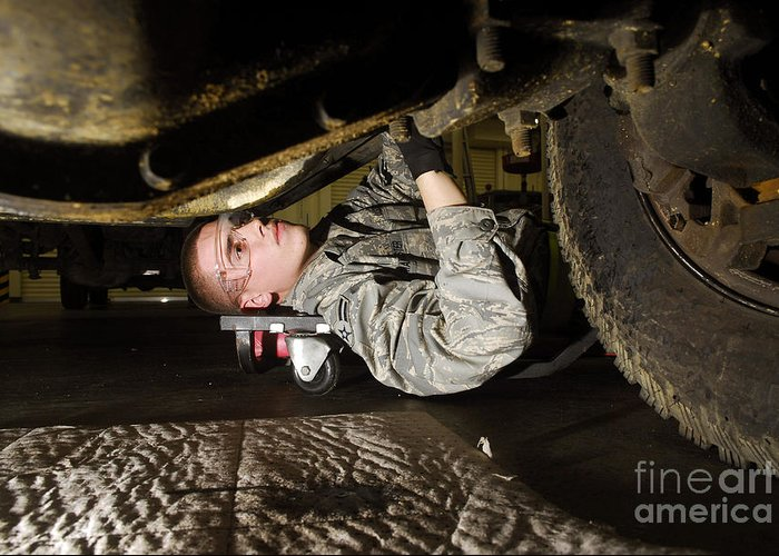 Airman Greeting Card featuring the photograph An Airman Inspects The Undercarriage by Stocktrek Images