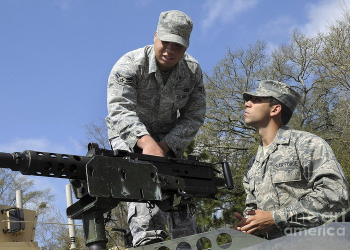 Military Greeting Card featuring the photograph An Airman Instructs A Cadet On How by Stocktrek Images