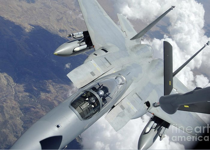 Horizontal Greeting Card featuring the photograph An F-15 Eagle Pulls Away From A Kc-135 by Stocktrek Images