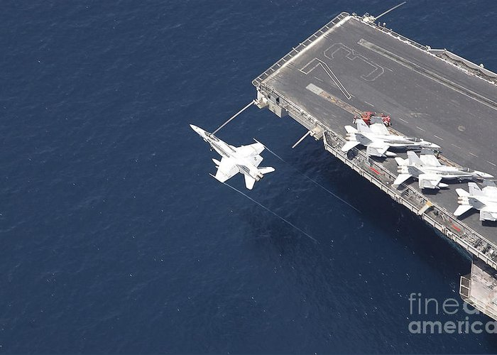Horizontal Greeting Card featuring the photograph An Fa-18 Hornet Flys Over Aircraft by Stocktrek Images