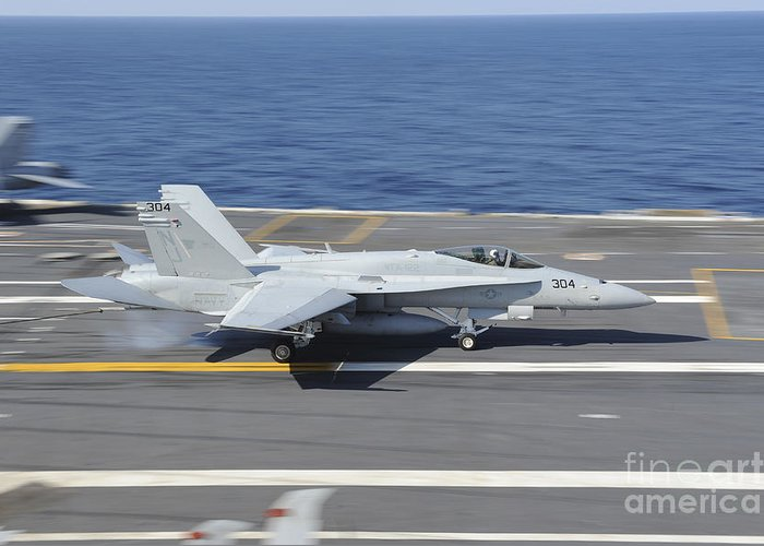 No People Greeting Card featuring the photograph An Fa-18c Hornet Lands Aboard Uss by Stocktrek Images
