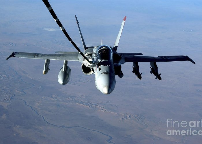 Color Image Greeting Card featuring the photograph An Fa-18c Hornet Receives Fuel by Stocktrek Images