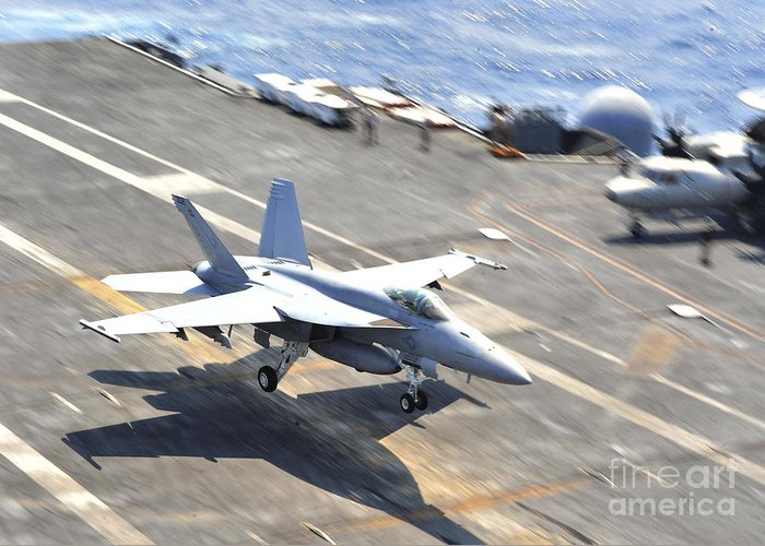 Aircraft Carrier Greeting Card featuring the photograph An Fa-18e Super Hornet Lands Aboard by Stocktrek Images