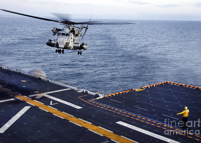 Pacific Ocean Greeting Card featuring the photograph An Mh-53e Sea Dragon Prepares To Land by Stocktrek Images