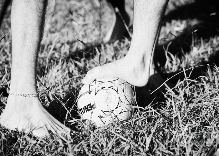 Men Greeting Card featuring the photograph Argentinian Hispanic Men Start A Football Game Barefoot In The Park On Grass by Joe Fox