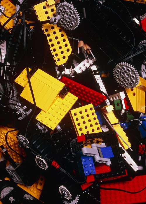 Brick Greeting Card featuring the photograph Assorted Lego Bricks And Cogs. by Volker Steger