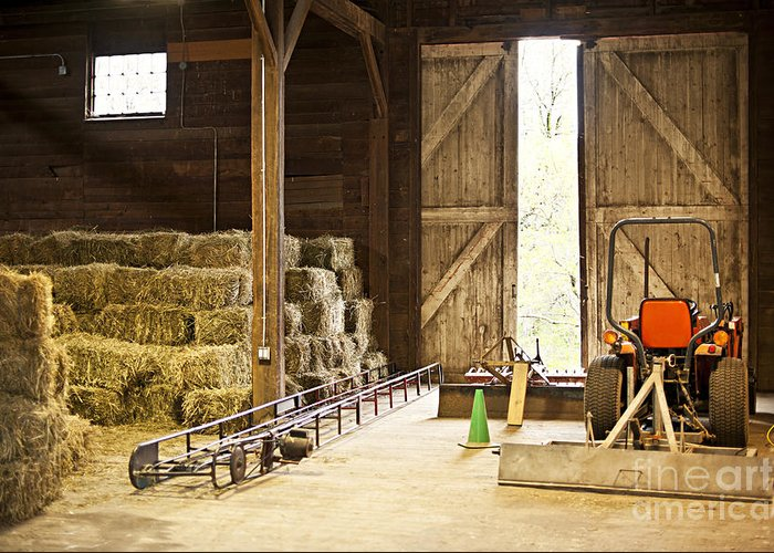 Barn Greeting Card featuring the photograph Barn With Hay Bales And Farm Equipment by Elena Elisseeva
