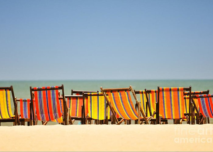 Azure Greeting Card featuring the photograph Beach Chairs Colorful by Panupong Roopyai