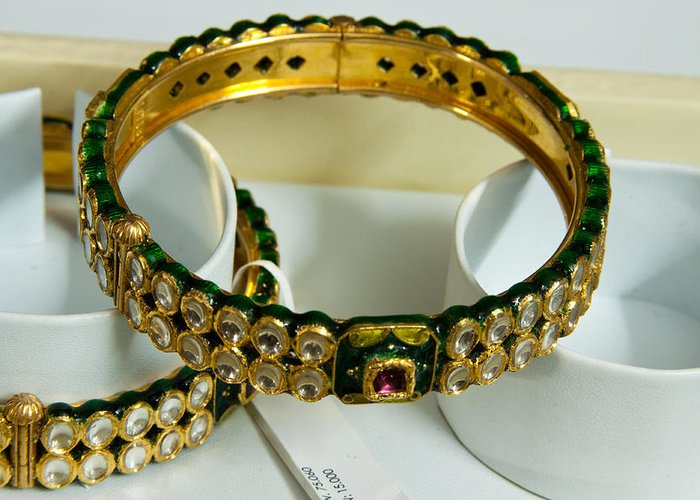 Bangle Greeting Card featuring the photograph Beautiful Green And Purple Covered Gold Bangles With Semi-precious Stones Inlaid by Ashish Agarwal