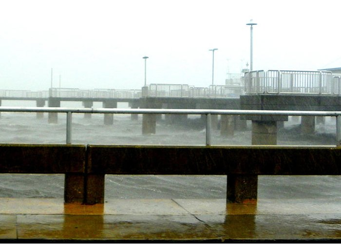 Cedar Key Pier Greeting Card featuring the photograph Big Dock Tropical Storm by Sheri McLeroy