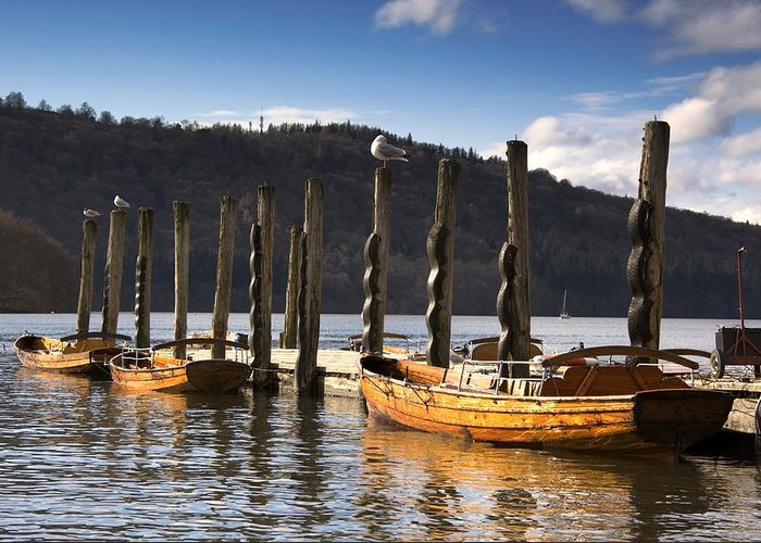 At The Pier Greeting Card featuring the photograph Boats Docked On A Pier, Keswick by John Short