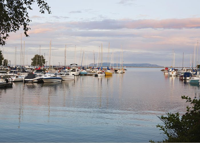 Tranquil Greeting Card featuring the photograph Boats In The Harbour At Sunset Thunder by Susan Dykstra