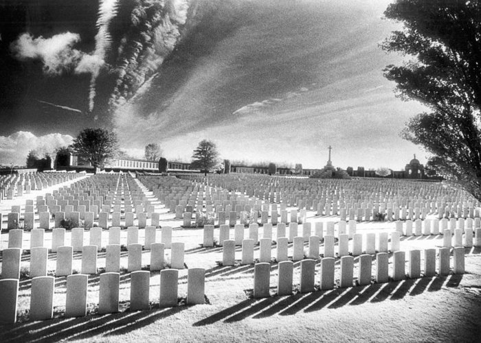 First World War; One; 1; Wwi; Ww1; 1st; I; Graves; Gravestones; Tombstones; Belgian; Commemorative; War Memorial; Vast; Stark; Shadows; Eerie; Atmospheric; Bright; Sunlight; Cross; Rows Greeting Card featuring the photograph British Cemetery by Simon Marsden