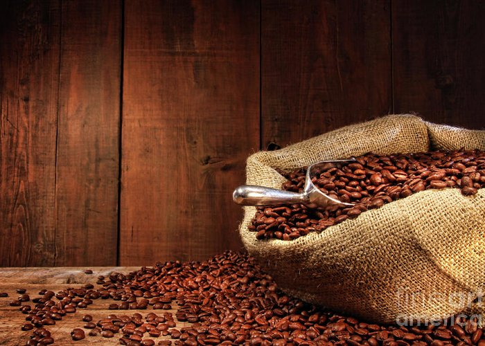 Aroma Greeting Card featuring the photograph Burlap Sack Of Coffee Beans Against Dark Wood by Sandra Cunningham
