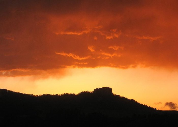 High Plains Sunset And Butte Greeting Card featuring the photograph Butte at sunset by J W Kelly