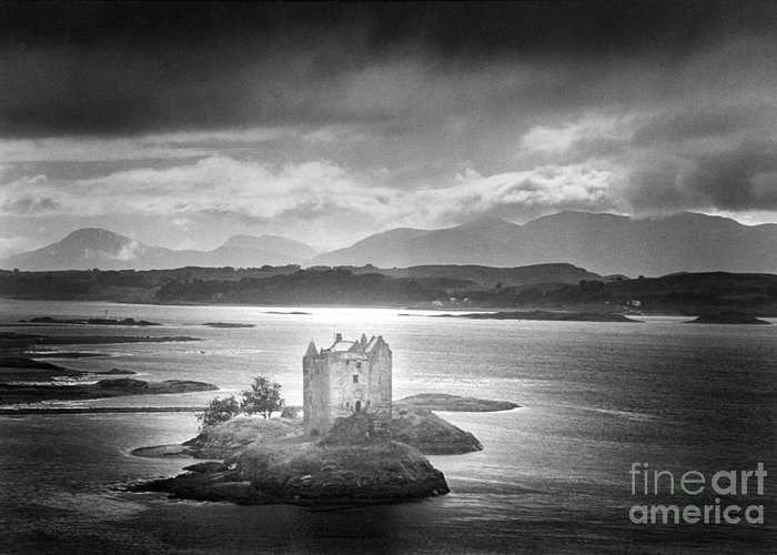 Medieval; Scottish; Landscape; Lake; Ominous; Foreboding; Brooding; Stormy Weather; Clouds; Dark; Mountains; Mountainous; Island; Exterior; Architecture; Gothic; Striking; Dramatic; Eerie; Mysterious; Mystery; Haunting; Haunted; Sinister; Spooky; Ghostly; Ethereal Greeting Card featuring the photograph Castle Stalker by Simon Marsden