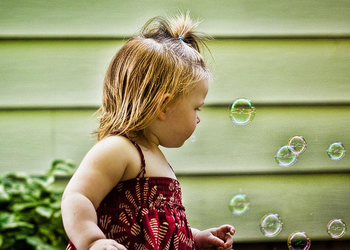 Girl Greeting Card featuring the photograph Chasing Bubbles by Matt Dobson
