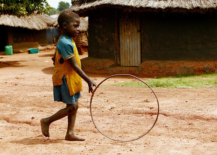 Hoop Greeting Card featuring the photograph Child Playing by Mauro Fermariello