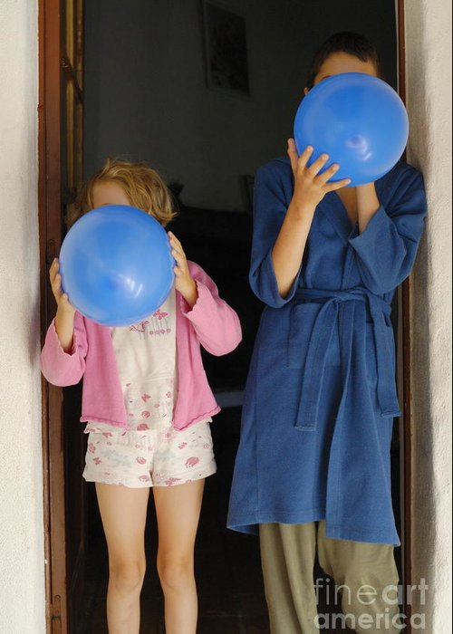 Nightwear Greeting Card featuring the photograph Children Blowing Up Balloons by Sami Sarkis