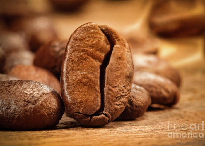 Aromatherapy Greeting Card featuring the photograph Closeup Shot Of A Coffee Bean On Wood by Sandra Cunningham