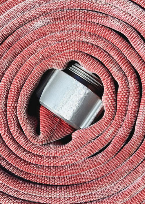 Close Up Greeting Card featuring the photograph Coiled Fire Hose by Skip Nall