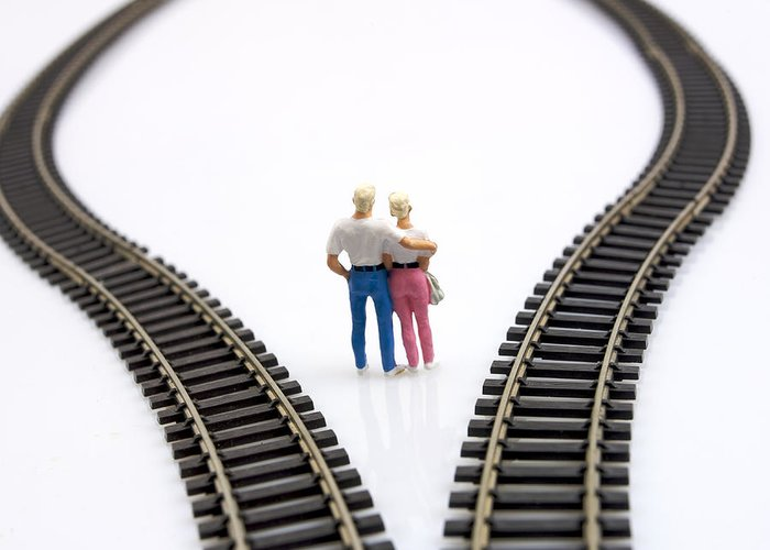 Unfocused  Greeting Card featuring the photograph Couple Two Figurines Between Two Tracks Leading Into Different Directions Symbolic Image For Making Decisions by Bernard Jaubert